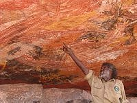 Garry pointing out features of rock art